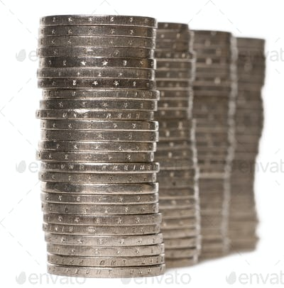 Stacks of 2 Euros Coins in front of white background
