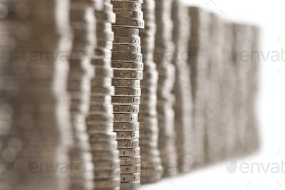 Close-up stacks of 2 Euros Coins in front of white background