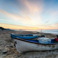 Blue & White Boats on Beach at Sunrise