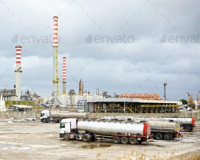 Oil refinery industry, smoke stacks and tanker lorry or truck