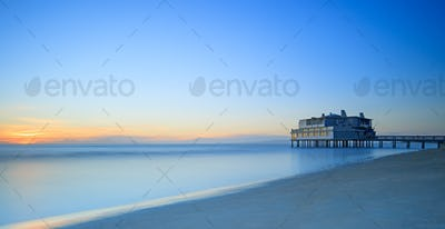 Pier and building on sea and beach. Follonica, Tuscany Italy