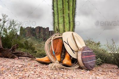 Cowboy items in desert