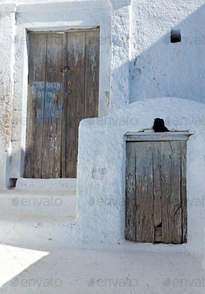Two rustic wooden doors