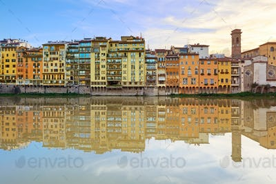 Arno river and buildings architecture landmark on sunset. Floren