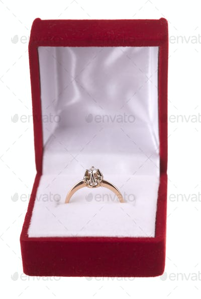 Golden diamond engage ring in a box isolated on white
