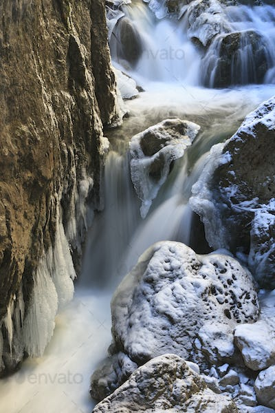 small waterfall in winter