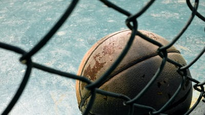Old Leather Basketball behind Wire Mesh