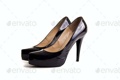 Pair of black patent leather female shoes isolated