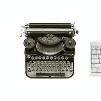 Old typewriter and modern keyboard