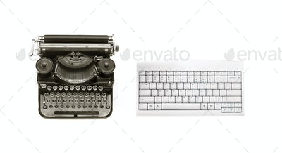 Old typewriter and modern keyboard
