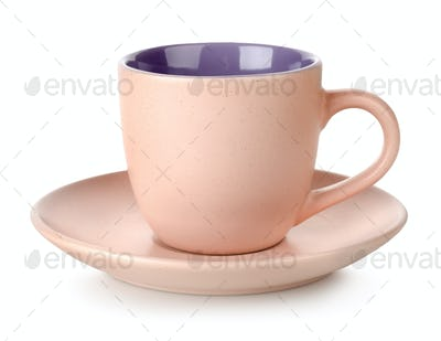 Pink cup and saucer isolated