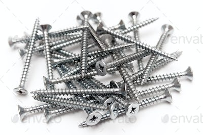 Bunch of Screws Isolated on a White Background