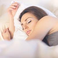 Asleep Woman Lying on Bed