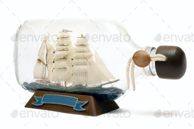 Ship in a Bottle Isolated on a White Background