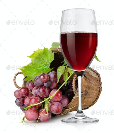 Wineglass and  grapes in a basket