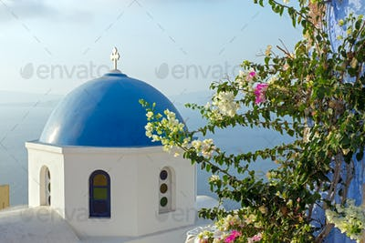 Church with flowers in Oia