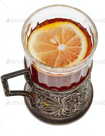 black tea with lemon in vintage glass