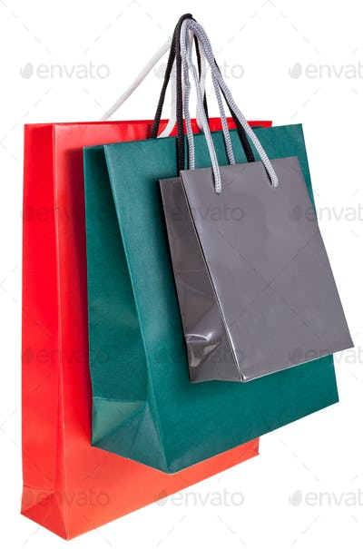 three paper shopping bags