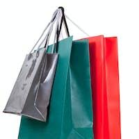three paper shopping bags