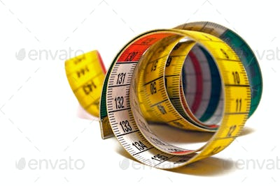 Rolled Measuring Tape Isolated on a White Background