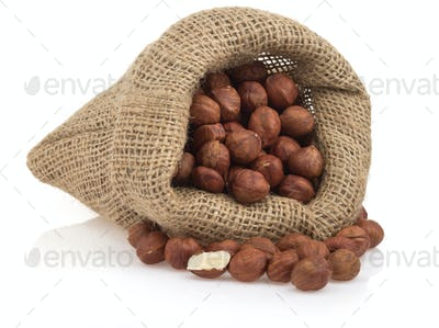 nuts hazelnut in bag isolated on white