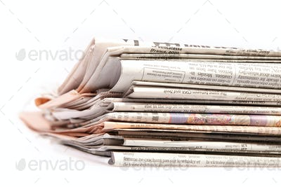 International newspapers on white.
