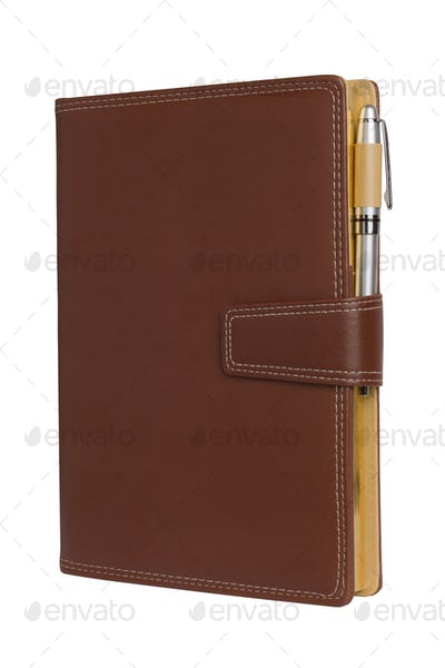 Leather notebook and pencil on white background.