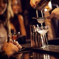 Barman Serving Cocktail Drinks