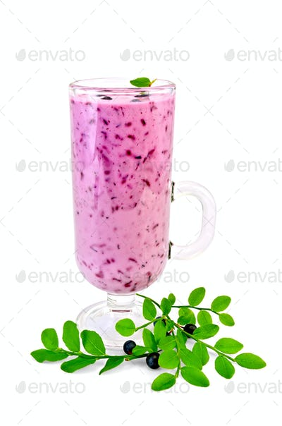 Milkshake with blueberries in a glass goblet