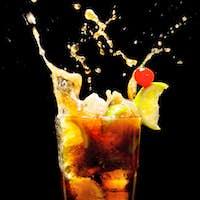 Splashing Cuba Libre Cocktail