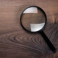 Magnifying Glass On Wooden Background