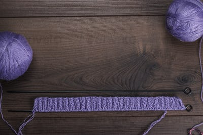 Knitting Needles And Balls Of Threads Background