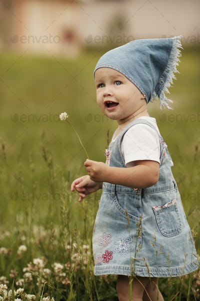 cute little girl with flower