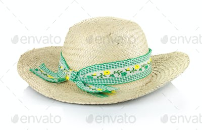 a straw hat with a green ribbon