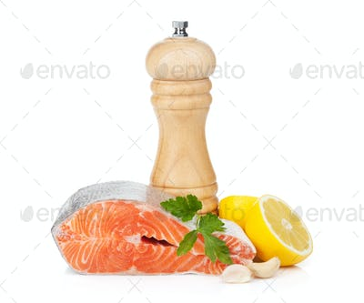 Salmon with herbs, pepper shaker and lemon
