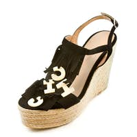 Raffia wedged fringed flip flop sandals with the word CHIC