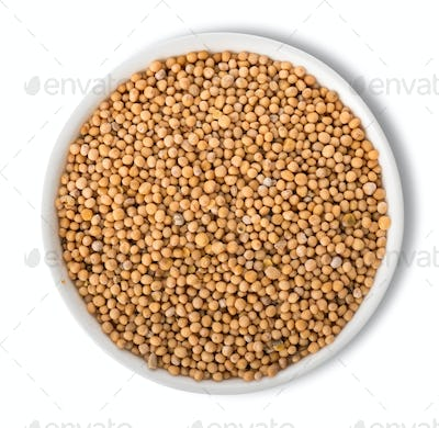 Mustard seeds in plate isolated