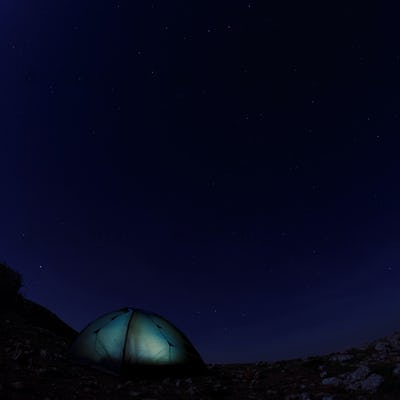 Tourist tent against the night sky
