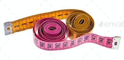 yellow and pink measure tapes