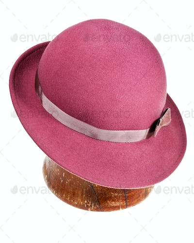 felt hat with wide brim on wooden block