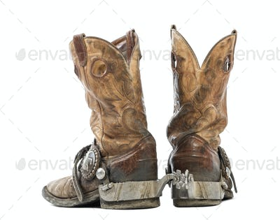 Rear view of a Pair of cowboy boots, isolated on white background