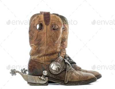 Side view of a pair of Cowboy boots with spurs, isolated on white