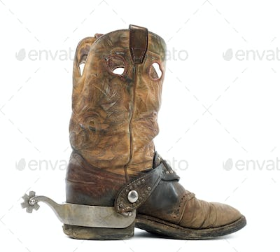 Side view of a Cowboy boot with spur, isolated on white