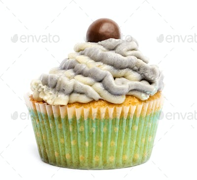 Cupcake with icing and chocolate decoration against white background in front of white background