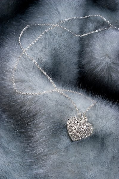 Chain with heart on fur
