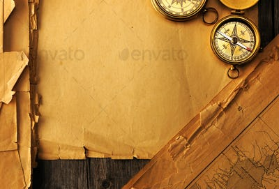 Antique compass over old map