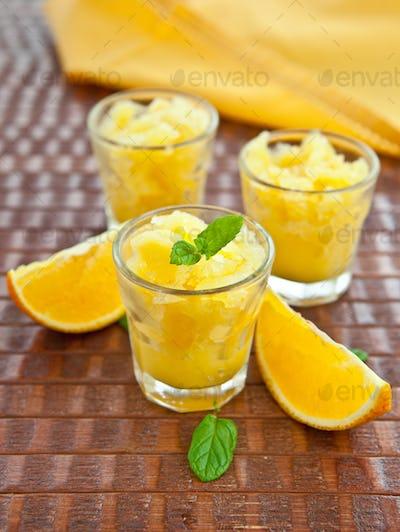Orange granita in three small glasses