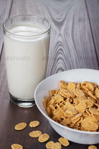 Glass Of Milk And Bowl With Cornflakes