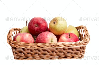 Autumn  basket with fruits on a white.