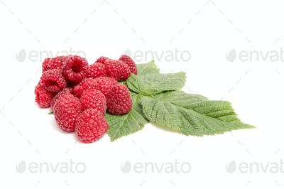 Juicy,ripe raspberries on a white.